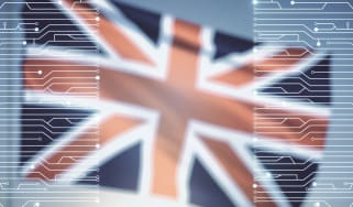 A blurred Union Jack flag behind digital imagery