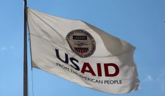 USAID flag flying over a blue sky