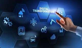 A hand hovering over the word 'digital transformation' on a blue background