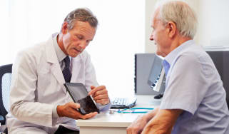 A GP with an elderly patient