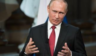 Vladimir Putin speaking at a podium