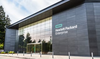 A view of a building with an HPE logo displayed on the outside