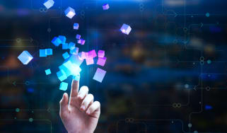 Female hand pointing at abstract glowing cubes on blurry circuit background
