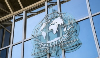 Interpol sign on a glass building