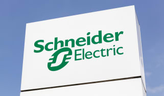 Schneider Electric sign with a blue sky in the background