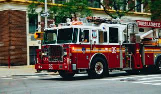 Fire truck driving down a city street