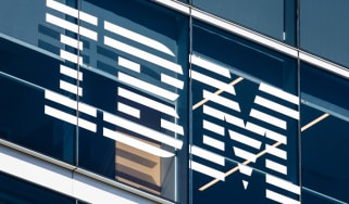 The IBM logo in White on the outside of its offices