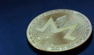 Monero crypto coin on a black background