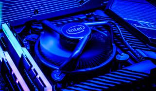 An Intel-branded CPU fan on a motherboard, lit in blue