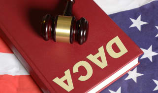 """Gavel on a book with """"DACA"""" on it"""