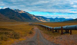 Long pipeline heading toward a mountain range