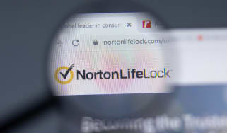 A magnified image showing the NortonLifeLock website url