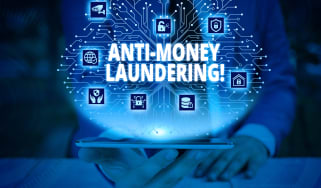 """""""Anti-Money Laundering"""" text overlaying tech images"""