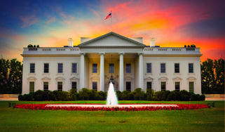 The White House pictured in front of a sunset