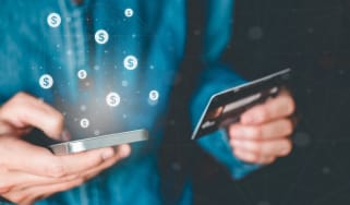 Man holding card and phone with fintech app