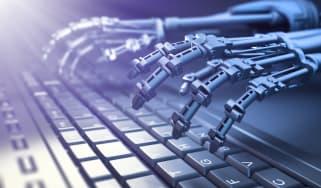 Robotic hands over a keyboard
