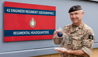 Lt Col Alex harris of the 42 Engineering Regiment holding an award