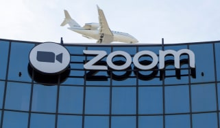 Zoom's head office in San Francisco with a plane right above it