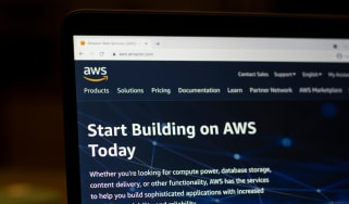 The AWS website displayed on a laptop in the dark