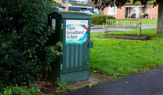 A green telecom cabinet advertising the release of fibre broadband in the area