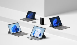 A photograph of the new Microsoft Surface family devices on a white backdrop