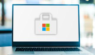 Laptop computer displaying logo of Microsoft Store