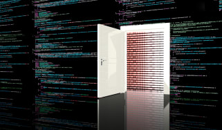 Door in a wall in a black room painted with computer code leading to a digital red background