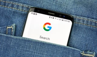 Google search on a smartphone poking out of a pocket