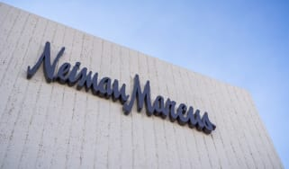 Neiman Marcus sign on a white brick building