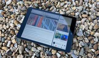 A photograph of the 12.9in 2021 Apple iPad Pro on a bed of stones