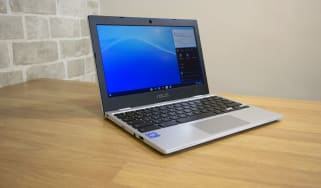 A photograph of the Asus Chromebook CX1 open on a table