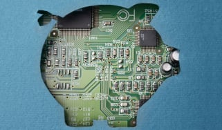 A cutout of a pig, to represent banking, on top of a circuit board