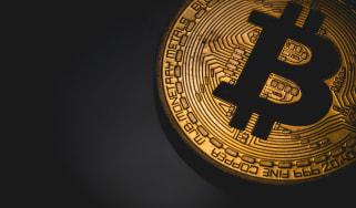 Bitcoin logo on a dark background