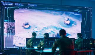A war room with a high tech display