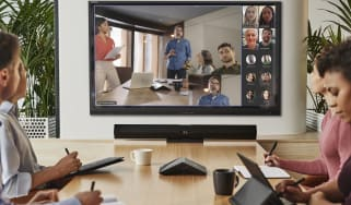 a group of employees taking part a video conference using HP's new hybrid work solutions