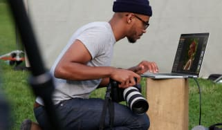 A photographer using the 2021 MacBook Pro with M1 Max chip