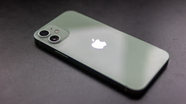 The Apple iPhone 12 mini face-down on a desk