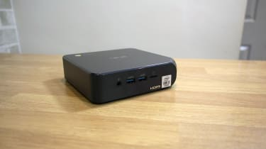 A photograph of the Asus Chromebox 4 sat on a table