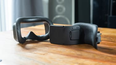 A photograph of the removable face gasket, battery pack and head pad from the HTC Vive Focus 3