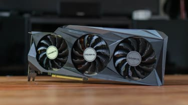 A photograph of the Gigabyte GeForce RTX 3090 GAMING OC 24G stood on its side on a table