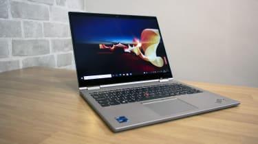 A photograph of the Lenovo ThinkPad X1 Titanium Yoga on a table