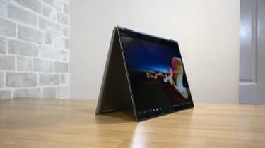 A photograph of the Lenovo ThinkPad X1 Titanium Yoga in tent mode