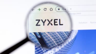 The Zyxel company logo as seen on its website through a magnifying glass