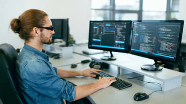 Software developer working on code
