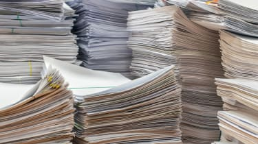 Stacks of paper on a desk in an office