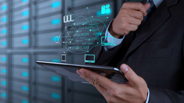 A man using a virtual server via a tablet