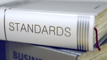 """Closeup view of a book bearing the title """"Standards"""" on the spine"""