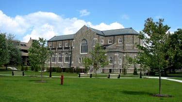 The Voorhees Computing Center building at Rensselaer Polytechnic Institute in Troy, New York, with lawn and trees at the forefront