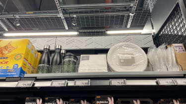 Morrisons products next to Amazon Fresh branded items on a shelf
