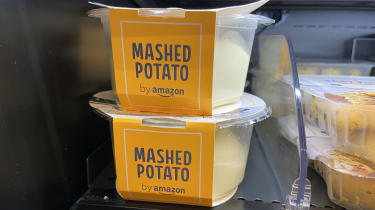 A close up of fresh mash from Amazon in pots on the shelf of a refrigerator in the shop